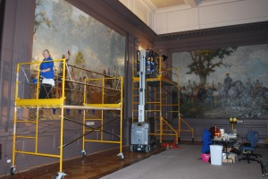 "Photograph of ""Spring"" and ""Summer"" murals being conserved. Credit: Virginia Historical Society."