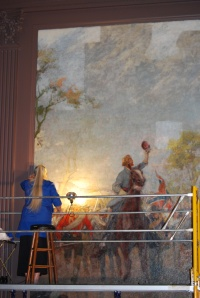 "Cleo Mullins, lead conservator, cleaning the ""Spring"" mural. Credit: Virginia Historical Society"