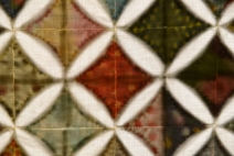Reverse of backlit cathedral window quilt