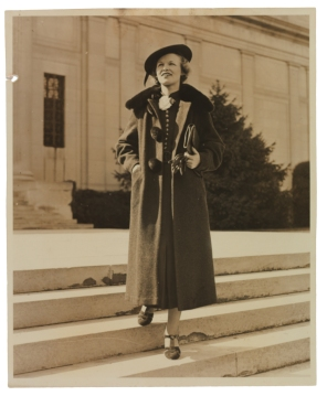 """Dorothy Elizabeth Hicks (1915-2002), circa 1937. Hicks modeled this fashionable outfit in front of """"Battle Abbey,"""" the colloquial moniker for the building which then housed the Confederate Memorial Association. By 1946 the Confederate Memorial Association was subsumed by the Virginia Historical Society; the society moved its headquarters to Battle Abbey in 1959. A photograph of Hicks (then """"Miss Dorothy Walton"""") similar to this one appeared in a local newspaper; both of these images are found in her scrapbook. (VHS call number: Mss5:7 H5292:1)"""