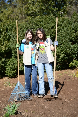 Girl Scouts working in the garden