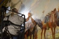 Lorainne Jan Brevig from Richmond Conservation Studio conducting in-painting on Gen. Beauregard.
