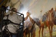 Lorainne Jan Brevig from Richmond Conservation Studio conducting in-painting on Gen. Beauregard.