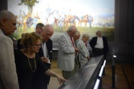 Guests at the May 6, 2015, unveiling studying the Cavalry (Autumn) Mural.