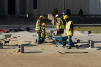 Workers installing limestone pavers in December 2014. (VHS Collection)