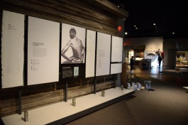 An unfinished display about antebellum slavery (foreground) and exhibit fabricators installing a display focusing on late-19th century railroads (background).