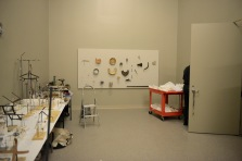 Objects on loan from the Department of Historic Resources are mounted on a panel that will be installed in The Story of Virginia. Hundreds of empty custom-made mounts wait on the tables at left.