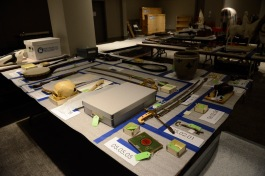 Collections staff have carefully organized hundreds of objects waiting to be installed in the exhibition.