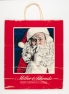 """Miller & Rhoads Holiday Shopping Bag, displays the holiday slogan, """"Where Christmas is a Legend"""" (Virginia Historical Society, 2008.142.1)"""