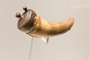 Image of Powder Horn (VHS accession number: 2000.138.21) on display in the Arming the Commonwealth exhibit at the Virginia Historical Society