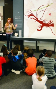 Caroline Legros working with a group of students in the Story of Virginia exhibition.